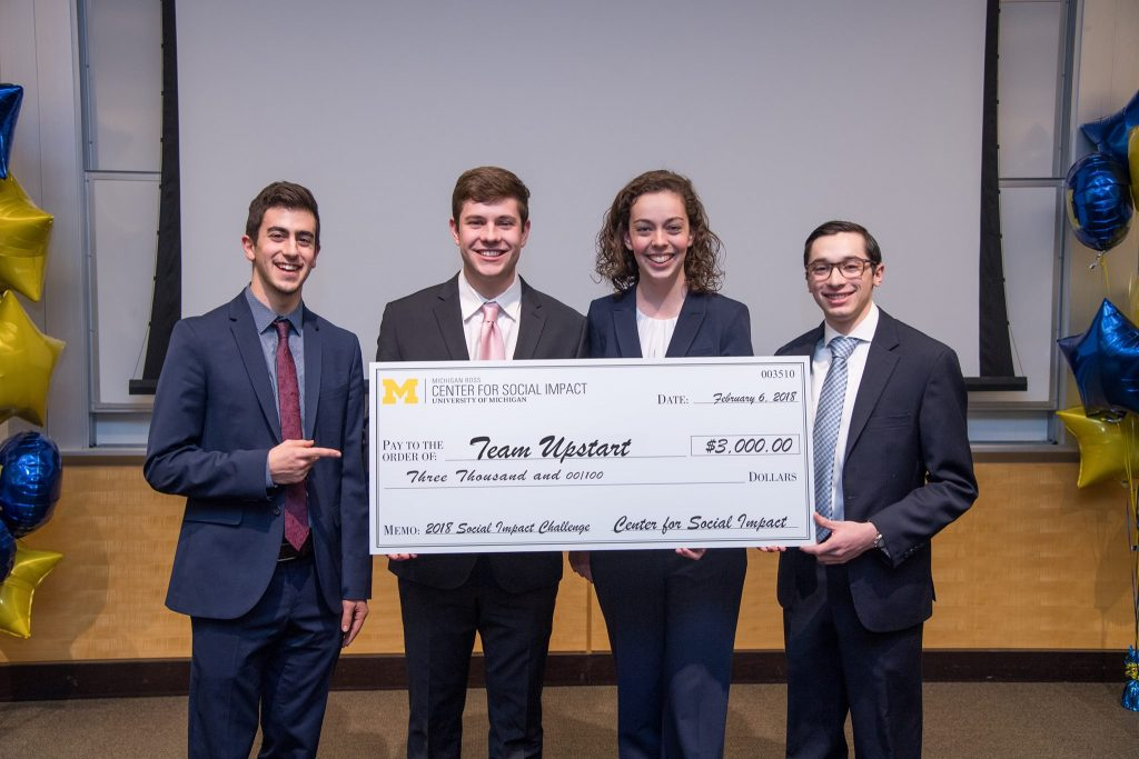Team Upstart poses with a check for $3,000 that they won in the 2018 Social Impact Challenge