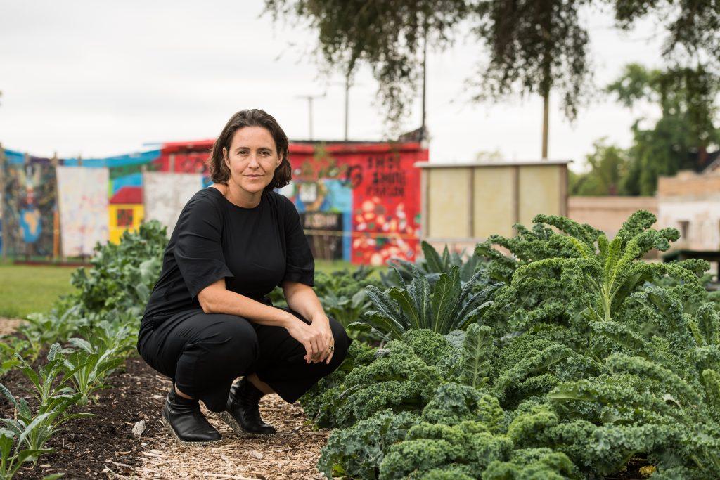 Anya Sirota poses with her flourishing plants.