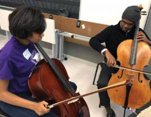 SMTD CELLO MASTERS STUDENT KAMYRON WILLIAMS (R) TEACHING CRESCENDO DETROIT STUDENT