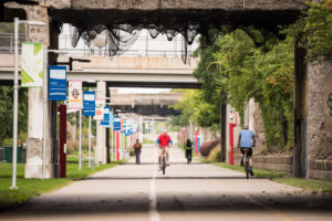 People biking and walking on the Dequindre Cut in Detroit.