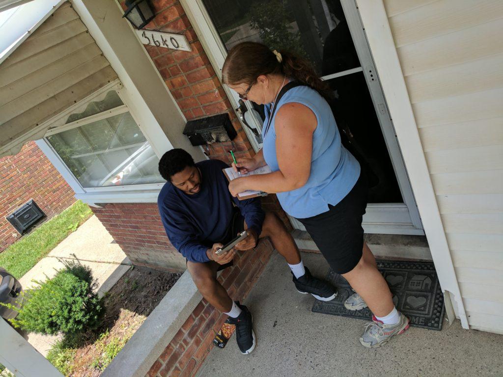 Diane McCloskey asks a Detroit resident questions for the Detroit Metropolitan Area Communities Study survey.