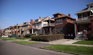 Row of houses in the Hope Village Initiative with green lawns and sidewalks