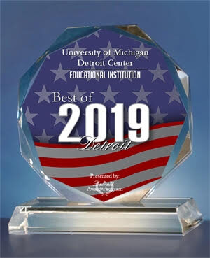 "Award saying ""University of Michigan Detroit Center 